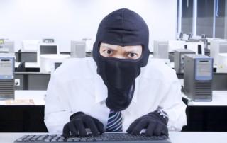 businessman wearing mask stealing